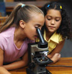kids looking through microscope
